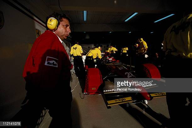 Jean Todt Team Principal for Scuderia Ferrari oversees the preparation of Gerhard Berger's Scuderia Ferrari SpA Ferrari F93A during practice for the...