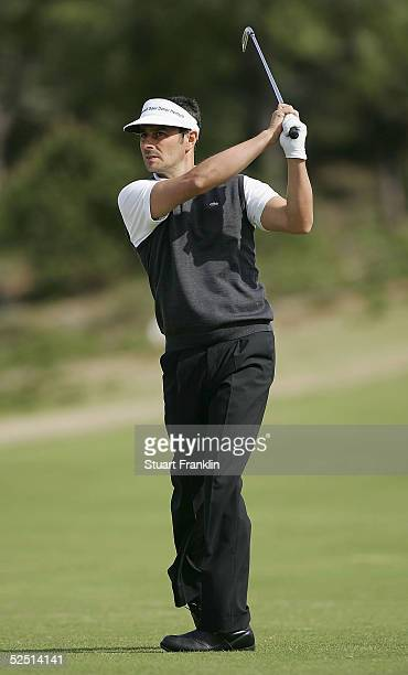 Jean Van De Velde of France plays his approach shot on the 16th hole during the first round of The Estoril Open de Portugal at The Quinta da Marinha...