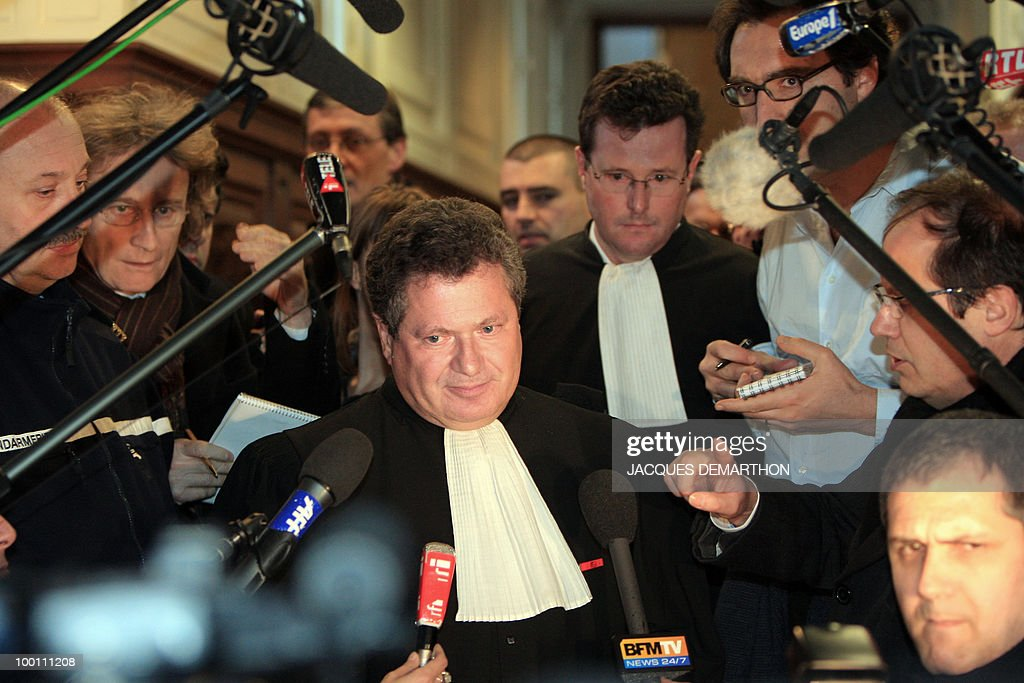 Jean Veil (C), the lawyer of the Societe Generale, addresses journalists after the French rogue trader Jerome Kerviel, whose unauthorised deals at Societe Generale cost the bank billions of euros, was taken into custody after a court hearing on February 8, 2008 in Paris. The appeals court upheld a plea from the state prosecutor's office that Kerviel should be placed in detention, 11 days after he was released after questioning.