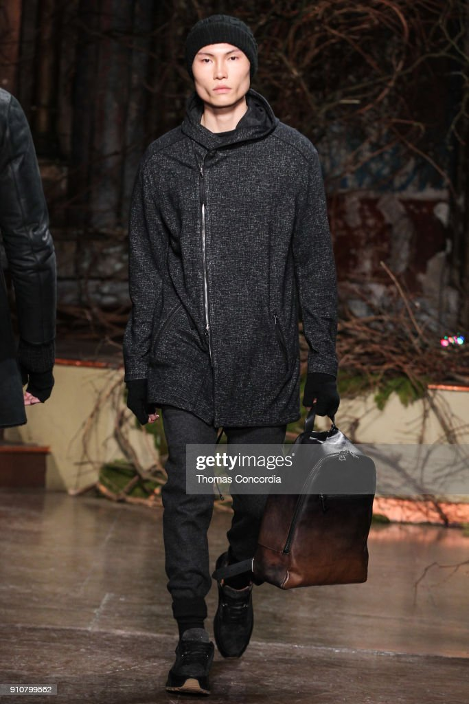 Jean walks the runway wearing John Varvatos Fall/Winter 2018 with makeup by Chika Chan for Make-Up Pro and Hair by Yannik D'Is for Cultler/Redken at the Angel Orensanz Foundation on January 26, 2018 in New York City.
