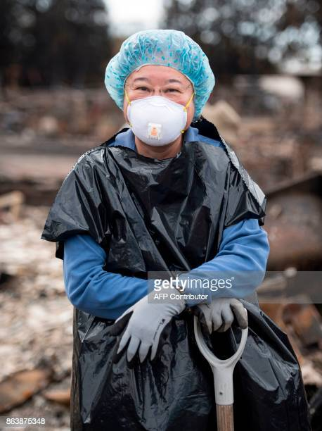 Jean Wang poses for a photo while searching for remains at her burned home in the Coffey Park area of Santa Rosa California on October 20 2017...