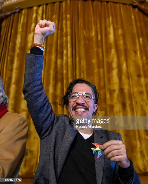 Jean Wyllys journalist and Brazilian politician exdeputy of PSOLSocialism and Liberty Party and LGBT activist raises his fist saluting the public...