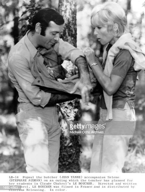 Jean Yanne and Stephane Audran in the woods in a scene from the film 'Le Boucher' 1970