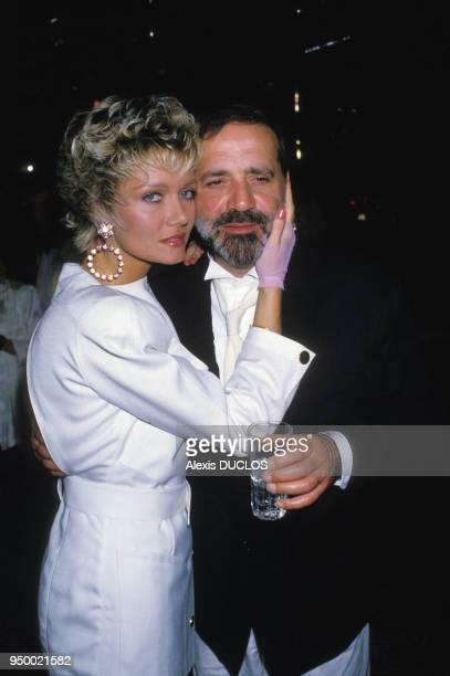 Jean Yanne et Mimi Coutelier lors d'une soirée en avril 1985 à Paris France
