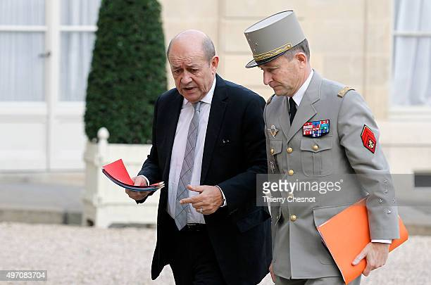 Jean Yves Le Drian French Minister of Defence and Chief of the Defence Staff General Pierre de Villiers arrive at the Elysee Palace in Paris for a...