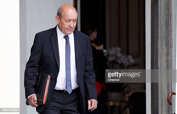 Jean Yves Le Drian French Minister of Defence leaves after a weekly cabinet meeting at the Elysee presidential palace on August 27 2014 in Paris...