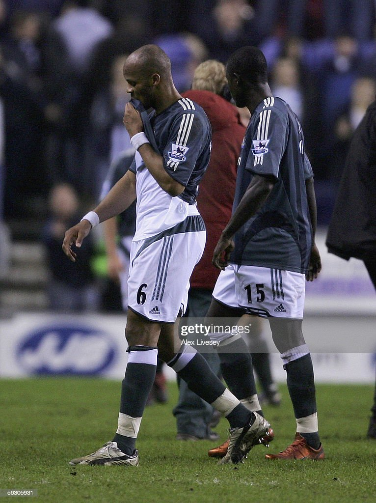 Jean-Alain Boumsong of Newcastle United walks from the pitch dejected after being defeated by Wigan Athletic in the Carling Cup fourth round match between Wigan Athletic and Newcastle United at the JJB Stadium on November 30, 2005 in Wigan, England