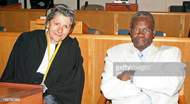 JeanBaptiste Gatete is pictured with his legal representative MariePierre Poulain at the International Criminal Tribunal for Rwanda in Arusha...