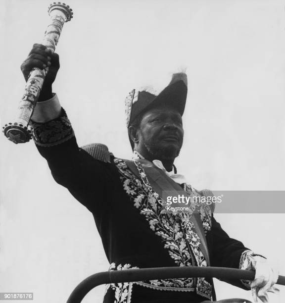 JeanBédel Bokassa Emperor of Central Africa takes the salute at a victory parade to celebrate his recent coronation 28th December 1977