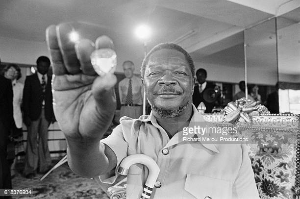 JeanBedel Bokassa holds up a large jewel Bokassa became president of the Central African Republic through a military coup and later declared himself...