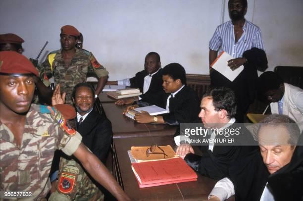 JeanBedel Bokassa lors de son procès avec ses avocats Nicolas Tiangaye Francis Szpiner et François Gibault en novembre 1986 à Bangui en République...