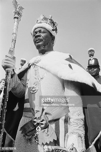 JeanBedel Bokassa wears a royal crown and cape and holds a scepter on the day he is crowned Bokassa I Emperor of the Central African Empire Bokassa...