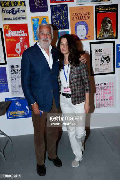 Jean-Bernard Hebey and his companion Elena Kalashnikova attend Albert Koski exposes its Rock&Roll Posters Collection at Galerie Laurent Godin on June...