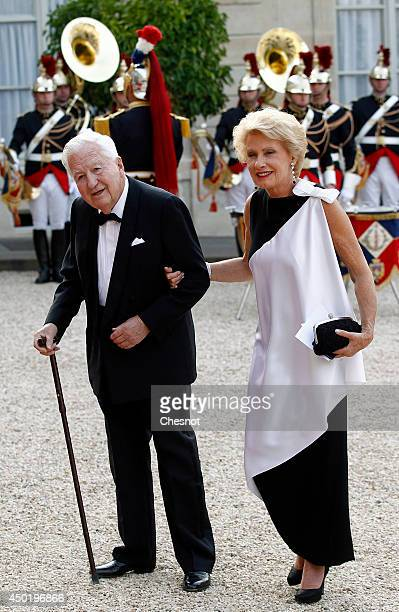JeanBernard Raimond and his wife arrive at the Elysee Palace for a State dinner in honor of Queen Elizabeth II hosted by French President Francois...