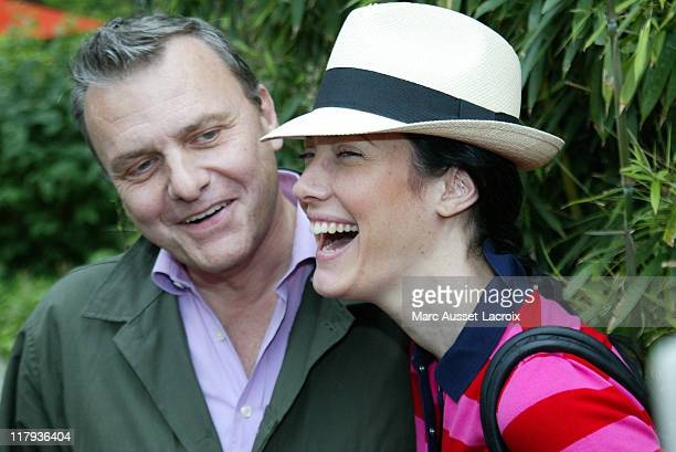 JeanCharles de Castelbajac and his wife Mareva Galanter pose in the 'Village' the VIP area of the French Open at Roland Garros arena in Paris France...