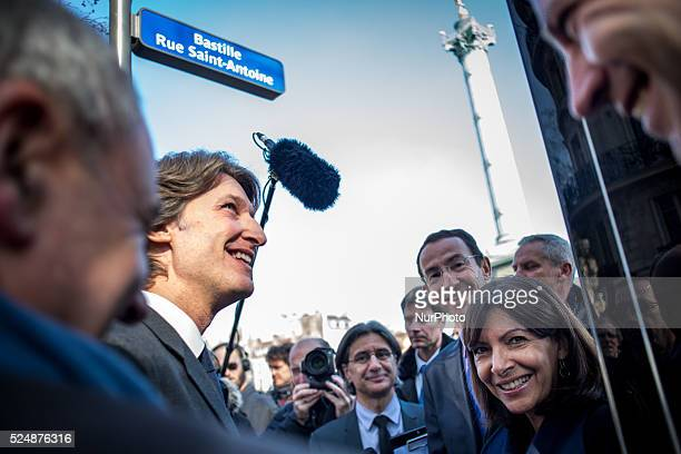 JeanCharles Decaux chairman of the board and coCEO of multinational advertising corporation JCDecaux smiles next to Mayor of Paris Anne Hidalgo...