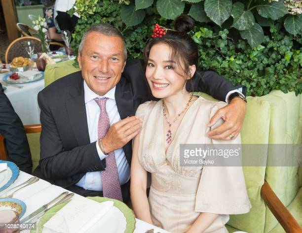 Jean-Christophe Babin and Shu Qi pose at the Bulgari exhibition in GUM as part of the Bulgari exhibition at Kremlin Museum on September 6, 2018 in...