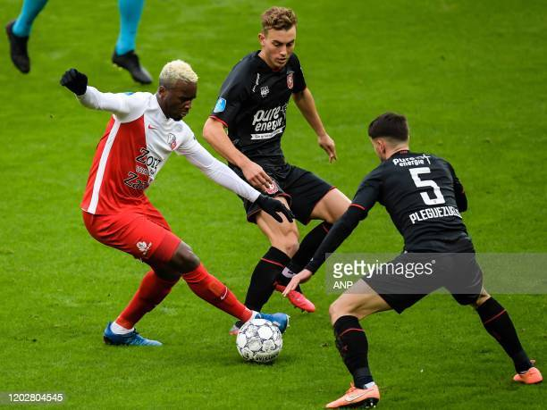 JeanChristophe Bahebeck of FC Utrecht Oriol Busquets of FC Twente Julio Pleguezuelo of FC Twente during the Dutch Eredivisie match between FC Utrecht...