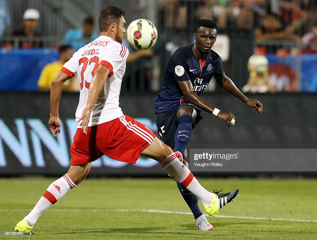 Jean-Christophe Bahebeck #15 of Paris Saint-Germain sends the ball past Jardel #33 of Benfica during the 2015 International Champions Cup match at BMO Field on July 18, 2015 in Toronto, Ontario, Canada.