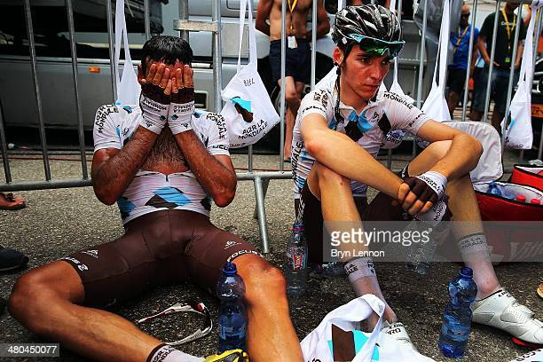 JeanChristophe Peraud of France and AG2R La Mondiale and team mate Romain Bardet recover after at the end of stage eight of the 2013 Tour de France a...