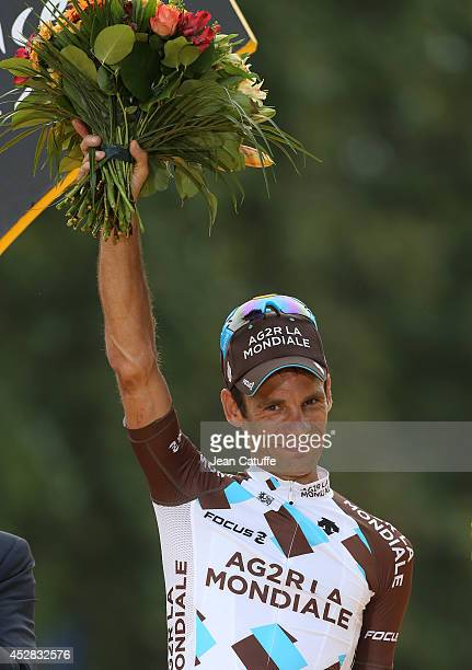 Jean-Christophe Peraud of France and AG2R La Mondiale celebrates his second ranking on the podium after the twenty one and last stage of the 2014...