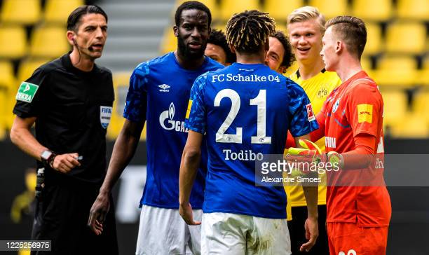 Jean-Clair Todibo of FC Schalke 04 is upset after a rough tackle by Erling Haaland of Borussia Dortmund during the Bundesliga match between Borussia...