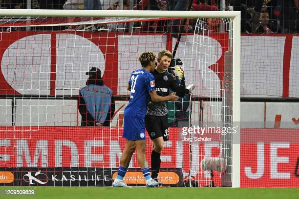 Jean-Clair Todibo of FC Schalke consoles Alexander Nuebel after he scores an own goal during the Bundesliga match between 1. FC Koeln and FC Schalke...
