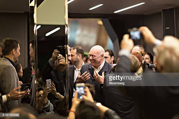 JeanClaude Biver chief executive officer of TAG Heuer International SA and chairman of Hublot SA center reacts as he mingles with attendees at the...