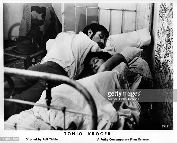 JeanClaude Brialy as Tonio Kroeger lays in a bed with Anaid Iplicjian in a scene from the movie Tonio Kroeger circa 1964