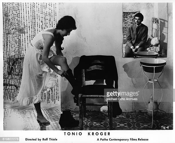 JeanClaude Brialy as Tonio Kroeger watches Anaid Iplicjian dress in a scene from the movie Tonio Kroeger circa 1964