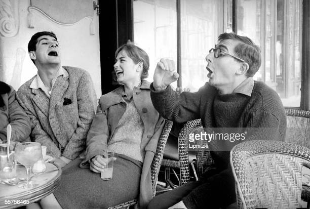 JeanClaude Brialy Juliette Mayniel and Claude Chabrol French filmmaker in the DeuxMagots Paris April 1959 LIP33860019