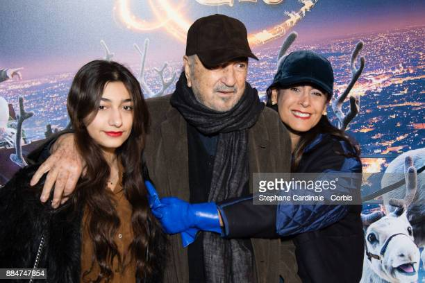 JeanClaude Carriere and his Wife Nahal Tajadod and their daughter Kiara attend the Santa Cie Paris Premiere at Cinema Pathe Beaugrenelle on December...