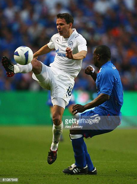 JeanClaude Darcheville of Glasgow Rangers watches Konstantin Zyrianov of Zenit St Petersburg during the UEFA Cup Final between Zenit St Petersburg...