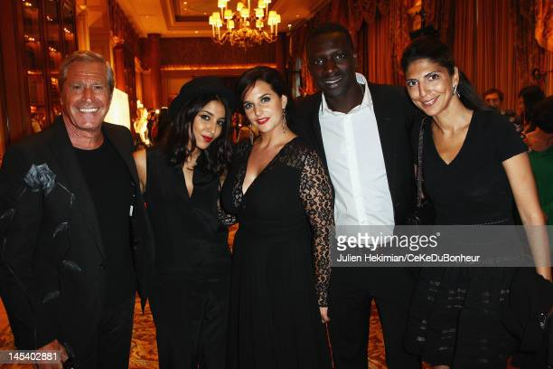 Jean-Claude Darmon, Leila Bekhti, Helene Sy, Omar Sy and Hoda Roche attend the 'Global Gift Gala' hosted by jewel designer Sheeva at Hotel George V...