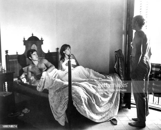 JeanClaude Drouot and Anna Karina are caught in bed by Nicol Williamson in a scene from the film 'Laughter in the Dark' 1969