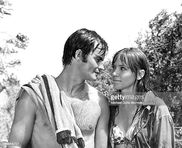 JeanClaude Drouot and Anna Karina in their swimsuits looking into one an others eyes in a scene from the film 'Laughter in the Dark' 1969