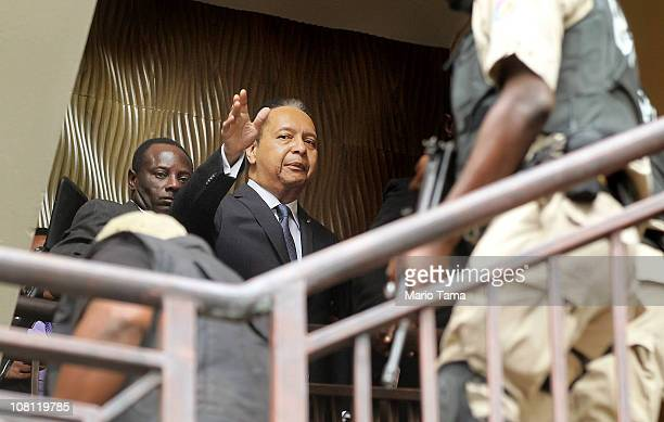 Jean-Claude Duvalier , the former Haitian leader known as 'Baby Doc', is taken into custody by Haitian police at the Hotel Karibe on January 18, 2011...