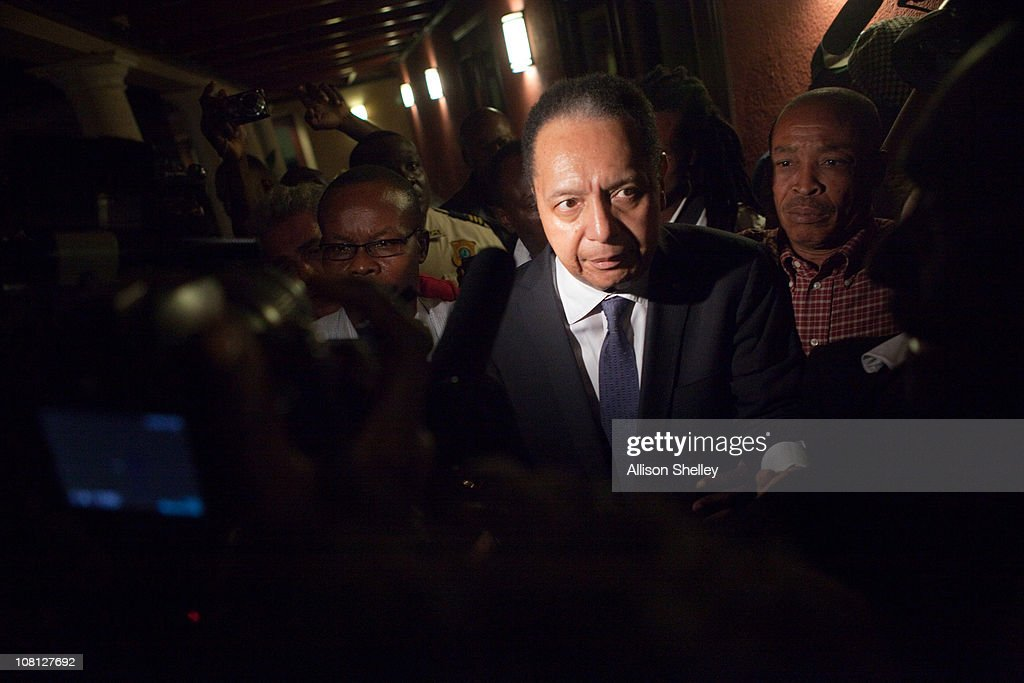 Jean-Claude Duvalier (C), the former Haitian leader known as 'Baby Doc', makes his way back into the Hotel Karibe after being questioned by Haitian authorities at a downtown courthouse January 18, 2011 in Port-au-Prince, Haiti. Duvalier was initially greeted by supporters upon returning to his homeland for the first time in 25 years from his exile in France. Duvalier was taken to a downtown courthouse and Haitian authorities presumably questioned Duvalier to determine whether he should be prosecuted for stealing from the treasury during his rule and for crimes against humanity.