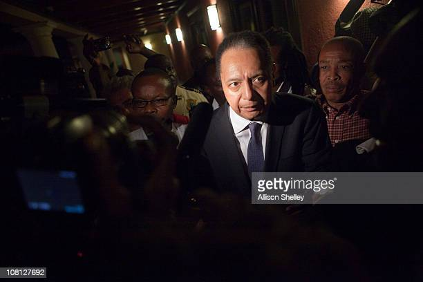"""Jean-Claude Duvalier , the former Haitian leader known as """"Baby Doc"""", makes his way back into the Hotel Karibe after being questioned by Haitian..."""