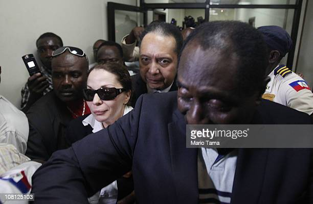 Jean-Claude Duvalier , the former Haitian leader known as 'Baby Doc', departs the courthouse after questioning with his girlfriend Veronique Roy as...