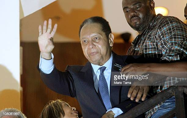 Jean-Claude Duvalier, the former Haitian leader known as 'Baby Doc', waves to supporters from a balcony of the Hotel Karibe on January 16, 2011 in...