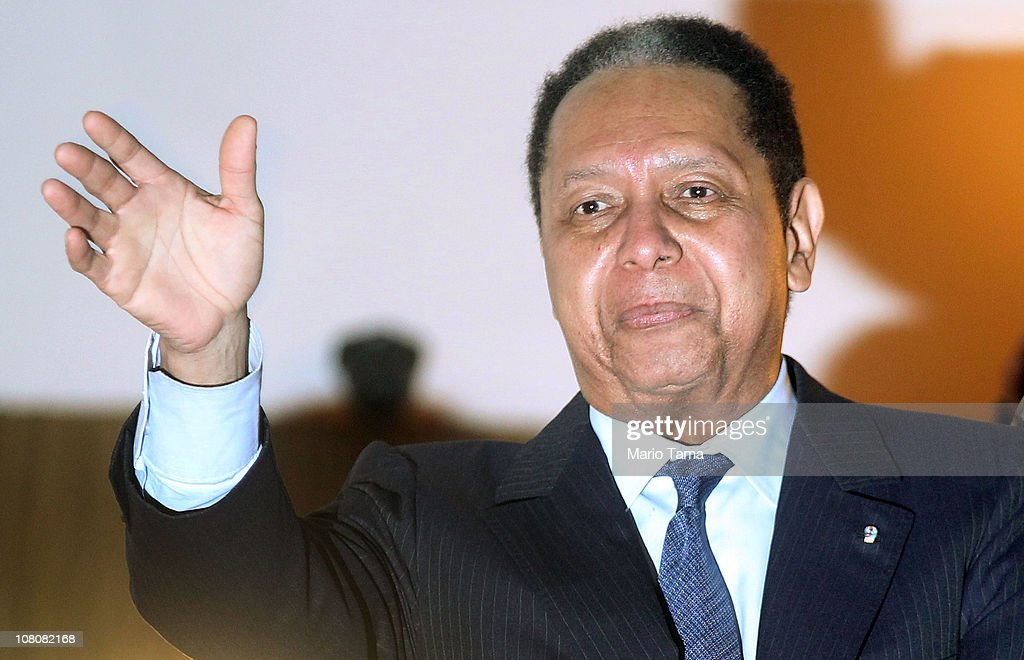 Jean-Claude Duvalier, the former Haitian leader known as 'Baby Doc', waves to supporters from a balcony of the Hotel Karibe on January 16, 2011 in Port-au-Prince, Haiti. Duvalier was greeted by supporters upon returning to his homeland for the first time in 25 years from his exile in France.