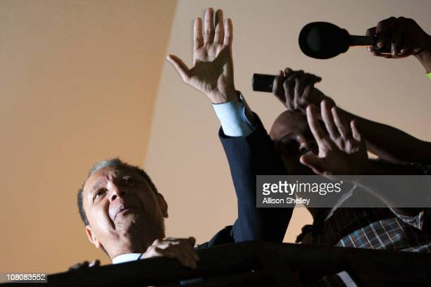 Jean-Claude Duvalier, the former Haitian leader known as 'Baby Doc', waves to the crowd from a balcony at Karibe Hotel on January 16, 2011 in...
