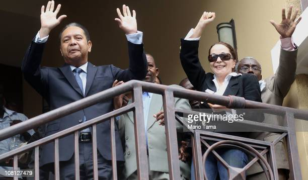 Jean-Claude Duvalier , the former Haitian leader known as 'Baby Doc', waves as he is taken into custody by Haitian police with his girlfriend...