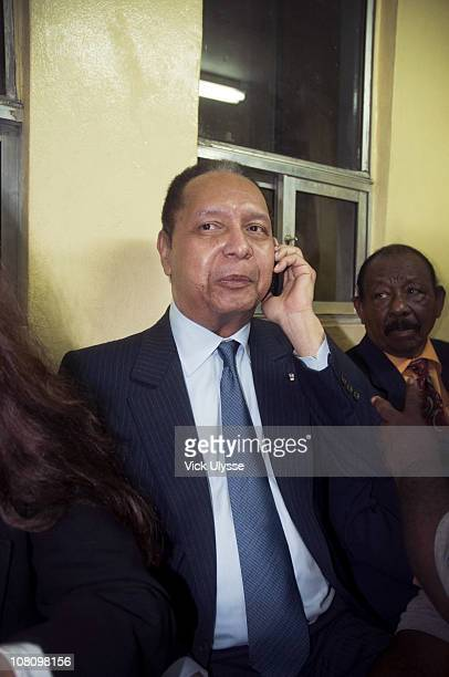 Jean-Claude Duvalier, the former Haitian leader speaks on his phone upon arriving at the airport on January 16, 2011 in Port-au-Prince, Haiti....