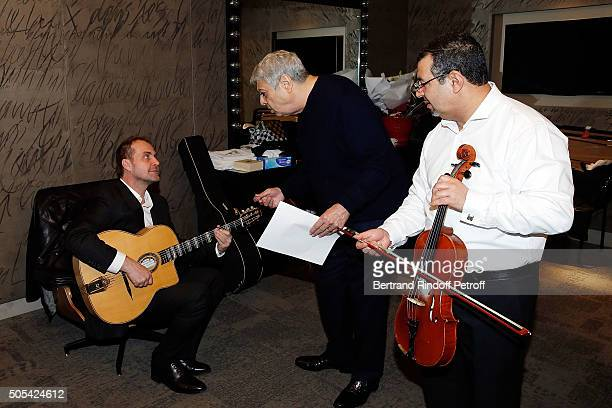 Jean-Claude Ghrenassia, his father Enrico Macias and Violinst Kamel Labbaci attend The Enrico Macias Show at L'Olympia on January 16, 2016 in Paris,...
