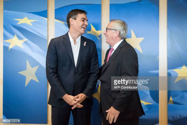 TOPSHOT JeanClaude Juncker European Commission President welcomes Pedro Sanchez leader of the Spanish Socialist Workers' Party in Brussels on October...