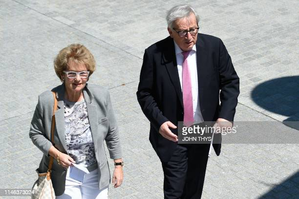 JeanClaude Juncker head of the European Commission and his wife Christiane Frising arrive to vote at a polling station in Capellen on May 26 as part...