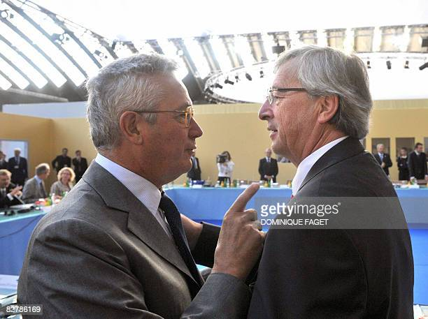 JeanClaude Juncker president of Eurogroup and Prime Minister of Luxembourg talks to Italian Finance Minister Giulio Tremonti on September 12 during a...