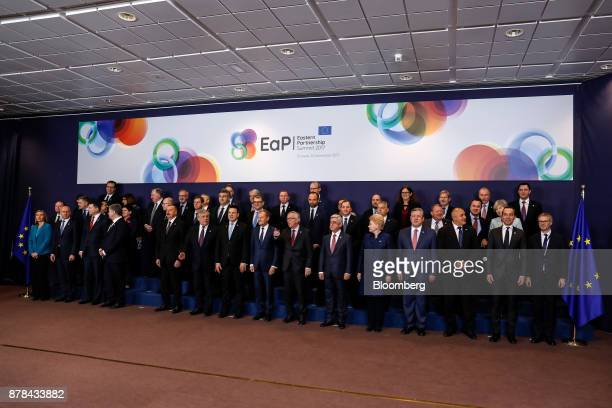 JeanClaude Juncker president of the European Commission center and Donald Tusk president of the European Union center left pose with European Union...